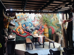 Photo by Gian Franco. Nemiranda built the dining area in a way that artists and non-artists would feel the Angono barrio vibe drummed up by papier-mâché of carabao heads,cement carvings depicting fiesta in Angono,  paintings, mosaic etc.