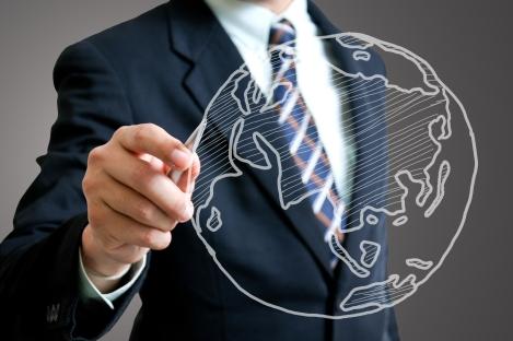 man-suit-drawing-globe-shutterstock_124246465